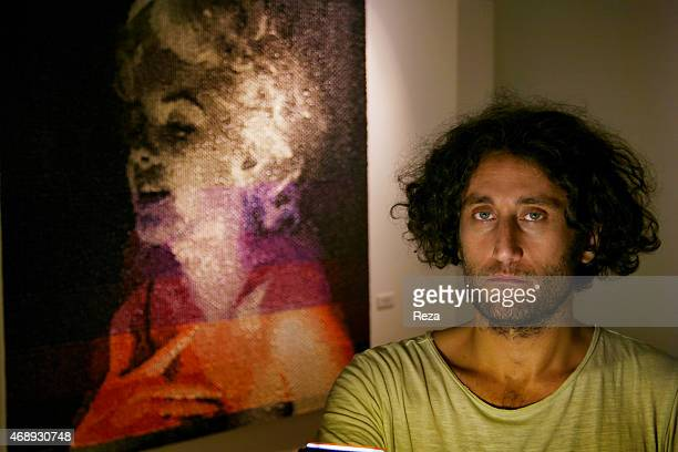 October 6 ALAN stanbul Beyoglu Istanbul Turkey A portrait of the Turkish artist Murat Pulat standing next to one of his paintings of Marilyn Monroe...