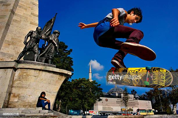 October 6 Barbaros Square Besiktas District Istanbul Turkey A teenage boy skateboards in Barbaros Square a popular skating destination on the...