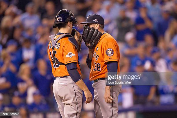 Houston Astros relief pitcher Oliver Perez and Houston Astros catcher Jason Castro talk on the mound during the MLB Playoff ALDS game 1 between the...