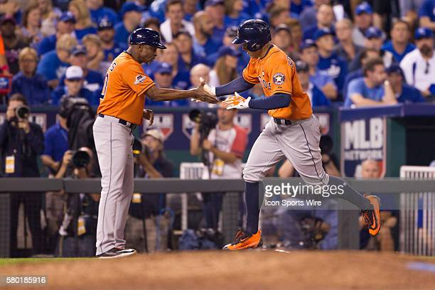 Houston Astros right fielder George Springer celebrates while rounding the bases after a home run during the MLB Playoff ALDS game 1 between the...