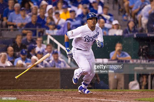 Kansas City Royals catcher Salvador Perez heads to first base as he watches a pop fly in the rain during the MLB Playoff ALDS game 1 between the...