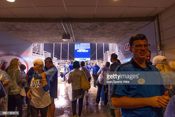 Kansas City Royals fans take refuge during a rain delay in the middle of the MLB Playoff ALDS game 1 between the Houston Astros and the Kansas City...