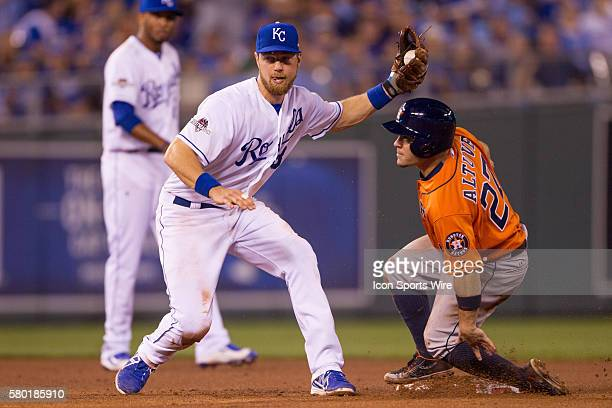 Kansas City Royals second baseman Ben Zobrist tries to tag out Houston Astros second baseman Jose Altuve during the MLB Playoff ALDS game 1 between...