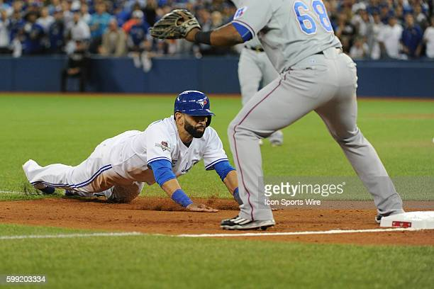 Toronto Blue Jays Right field Jose Bautista [4530] slides into third base during ALDS Game 1 between the Texas Rangers and Toronto Blue Jays at...
