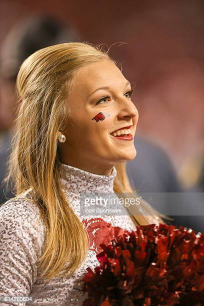 Razorback cheerleader looks into the crowd during a game between The University of Alabama Crimson Tide and The University of Arkansas Razorbacks at...