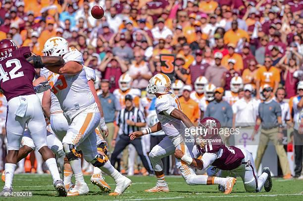 A Tennessee Volunteers quarterback Joshua Dobbs' fumble draws the attention of everyone as Texas AM Aggies defensive lineman Myles Garrett drags him...