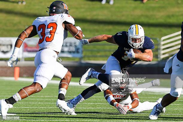 Chattanooga Mocs running back Derrick Craine breaks a tackle and runs for a first down during the NCAA football game between UT Chattanooga and...
