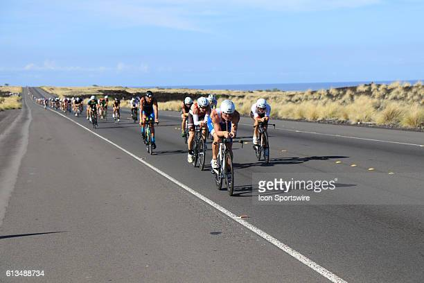 Competitors ride their bikes along the South Kohala coast during the Ironman World Championship on the Big Island of Hawaii More than 2300...