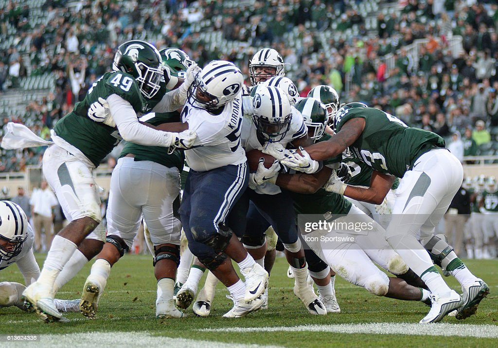 Cougars running back Jamal Williams (21) fights for the end zone and scores during a non-conference NCAA football game between Michigan State and BYU at Spartan Stadium, East Lansing, MI.