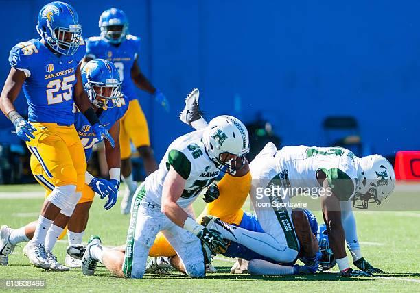 Hawaii Warriors linebacker Ikem Okeke crashes down on San Jose State Spartans wide receiver Rahshead Johnson on the kick off during the Mountain West...