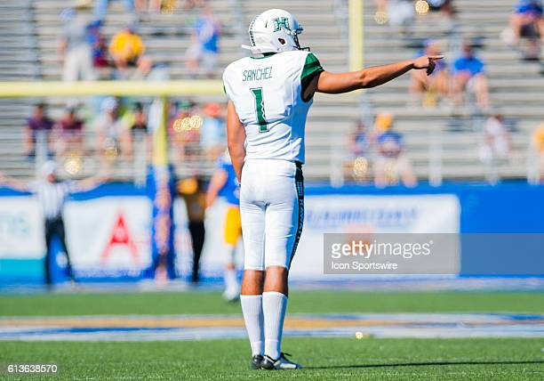 Hawaii Warriors place kicker Rigoberto Sanchez signals that he is ready to kick off the ball during the Mountain West Conference game between San...