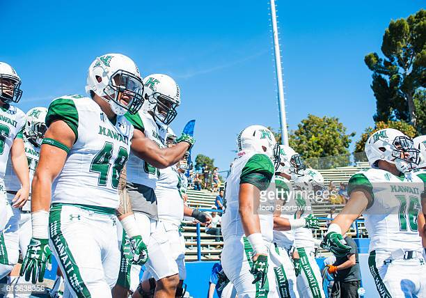 Hawaii Warriors players march onto the field prior to the Mountain West Conference game between San Jose State Spartans verses the Hawaii Warriors at...