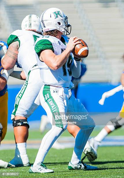 Hawaii Warriors quarterback Dru Brown survives the field during the Mountain West Conference game between San Jose State Spartans verses the Hawaii...