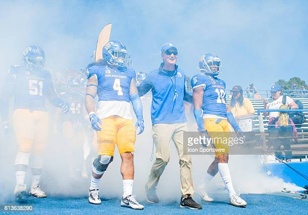 Head coach Ron Caragher leads his San Jose State Spartans out onto the field prior to the Mountain West Conference game between San Jose State...