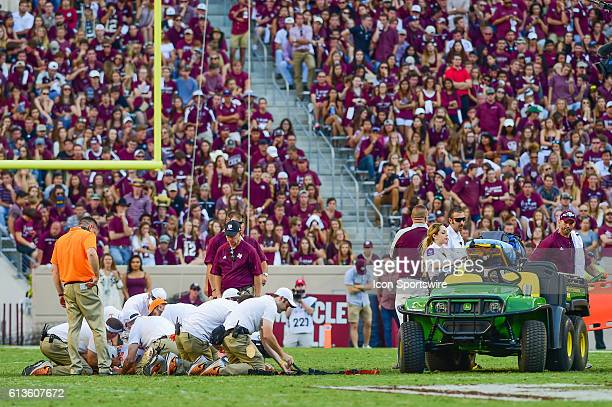 Medical crews tend to Tennessee Volunteers defensive lineman Danny O'Brien during the Tennessee Volunteers vs Texas AM Aggies game at Kyle Field...