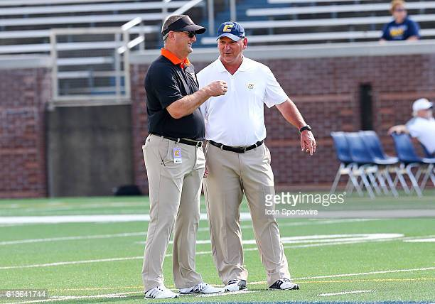 Mercer Bears head coach Bobby Lamb and Chattanooga Mocs head coach Russ Huesman speak to each other before the NCAA football game between UT...