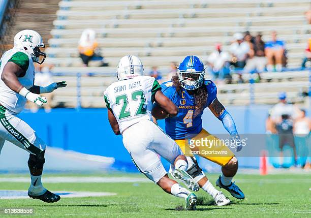 San Jose State Spartans linebacker Christian Tago stops Hawaii Warriors running back Diocemy Saint Juste in his tracks during the Mountain West...