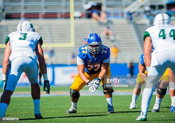 San Jose State Spartans offensive tackle Evan Sarver keeps an eye out on both Hawaii Warriors players during the Mountain West Conference game...