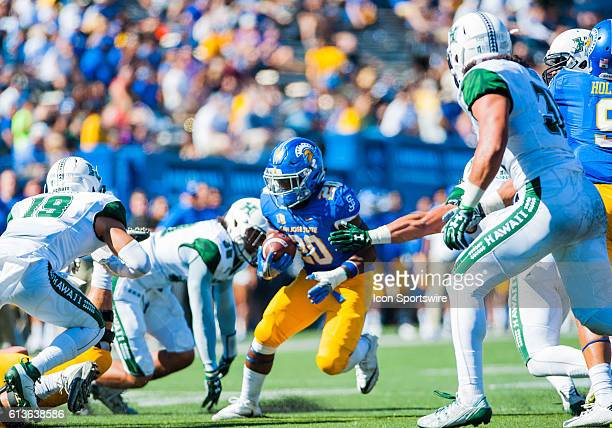 San Jose State Spartans running back Malik Roberson tries to get past Hawaii Warriors defenders during the Mountain West Conference game between San...