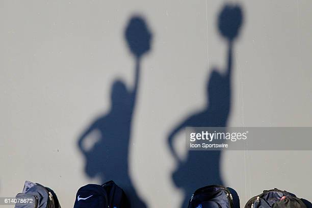Silhouettes of Toledo Rockets cheerleaders are seen on the stadium wall during game action between the Toledo Rockets and the Eastern Michigan Eagles...