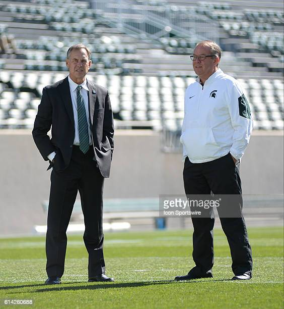 Spartans Head Coach Mark Dantonio and Athletics Director Mark Hollis chat prior to a nonconference NCAA football game between Michigan State and BYU...