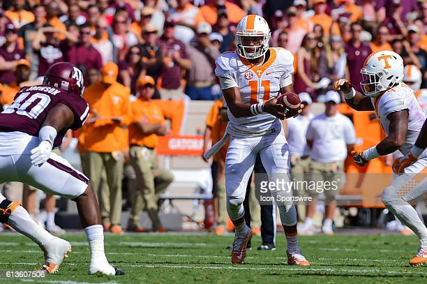 Tennessee Volunteers quarterback Joshua Dobbs fakes before taking the ball around the left side during the Tennessee Volunteers vs Texas A&M Aggies...
