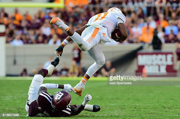 Tennessee Volunteers quarterback Joshua Dobbs is tripped up by Texas AM Aggies defensive back Armani Watts during the Tennessee Volunteers vs Texas...
