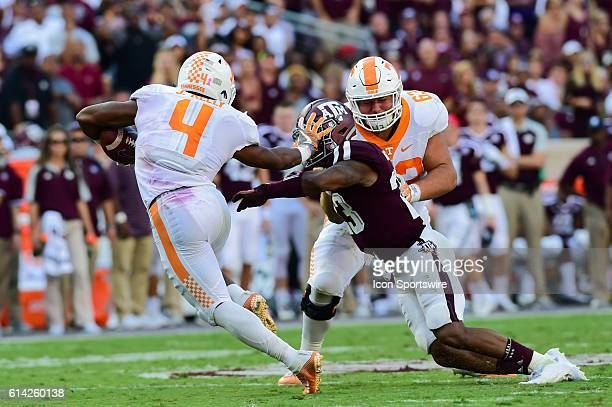 Tennessee Volunteers running back John Kelly stiff arms Texas AM Aggies defensive back Armani Watts during the Tennessee Volunteers vs Texas AM...