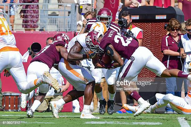 Texas A&M Aggies defensive back Armani Watts steals the ball from Tennessee Volunteers running back Alvin Kamara for a fumble recovery after a long...