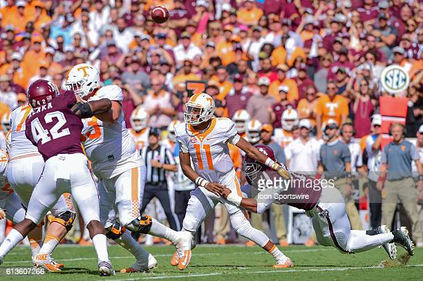 Texas A&M Aggies defensive lineman Myles Garrett forces a fumble on Tennessee Volunteers quarterback Joshua Dobbs during the Tennessee Volunteers vs...