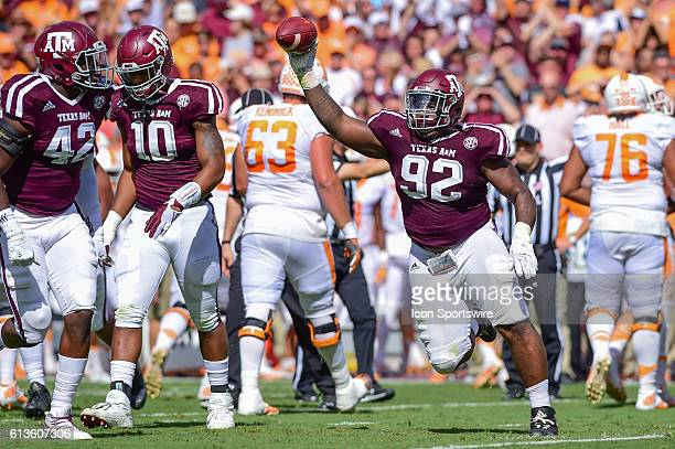 Texas A&M Aggies defensive lineman Zaycoven Henderson celebrates his fumble recovery from Tennessee Volunteers quarterback Joshua Dobbs during the...