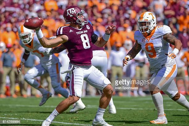 Texas AM Aggies quarterback Trevor Knight throws an opening series interception under pressure by Tennessee Volunteers defensive end Derek Barnett...