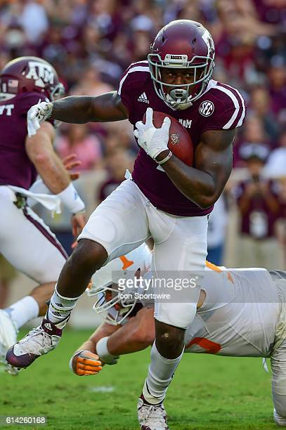 Texas A&M Aggies running back Keith Ford slips a tackle as he looks for running room around the right side during the Tennessee Volunteers vs Texas...