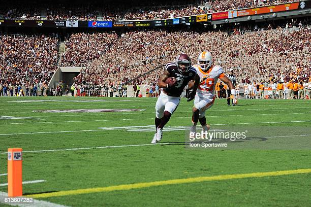 Texas A&M Aggies wide receiver Christian Kirk runs by Tennessee Volunteers defensive back Evan Berry enroute to a first half touchdown during the...