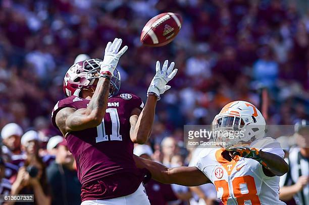 Texas A&M Aggies wide receiver Josh Reynolds hauls in a long ball over Tennessee Volunteers defensive back Baylen Buchanan during the Tennessee...