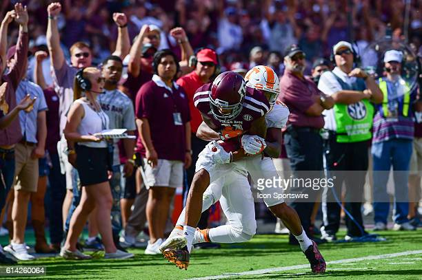 Texas A&M Aggies wide receiver Josh Reynolds maintains control of a long ball as Tennessee Volunteers defensive back Baylen Buchanan defends during...