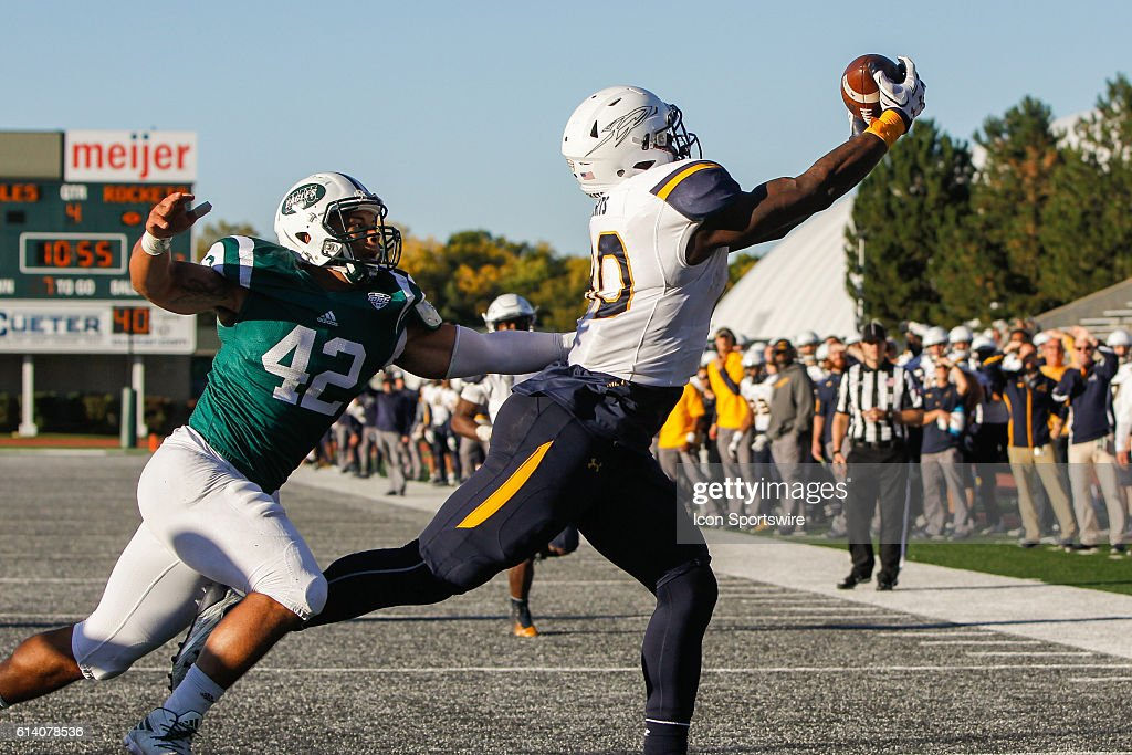 Toledo Rockets tight end Michael Roberts (80) catches a touchdown pass during game action between the Toledo Rockets and the Eastern Michigan Eagles played at Rynearson Stadium in Ypsilanti, Michigan.