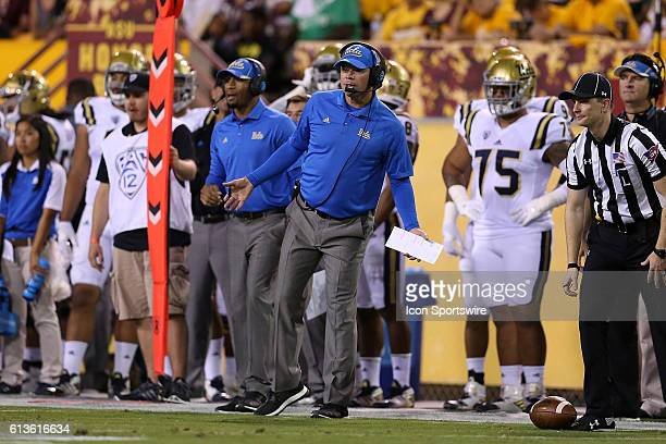 Bruins head coach Jim Mora watches the action during the first half of the Pac-12 college football game against the Arizona State Sun Devils at Sun...