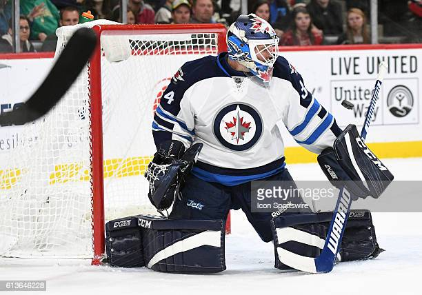 Winnipeg Jets Goalie Michael Hutchinson makes a save during a preseason NHL matchup between the Minnesota Wild and the Winnipeg Jets at the Xcel...