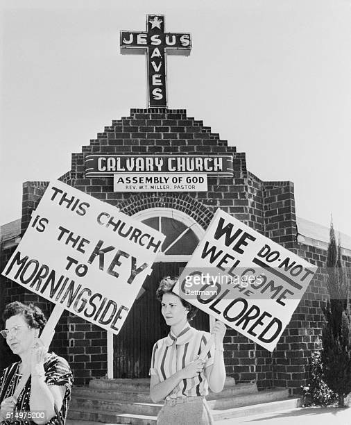 October 9 1956 Fort Worth Texas Mrs ET Holden and Mrs Peggy Richard picket the Calvary Assembly of God church After the Pastor Reverend WT Miller...