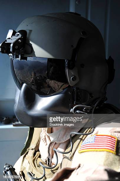 October 9, 2011 - U.S. Air Force flight engineer looks out over Afghanistan while flying in an Afghan Air Force Mi-17 helicopter.