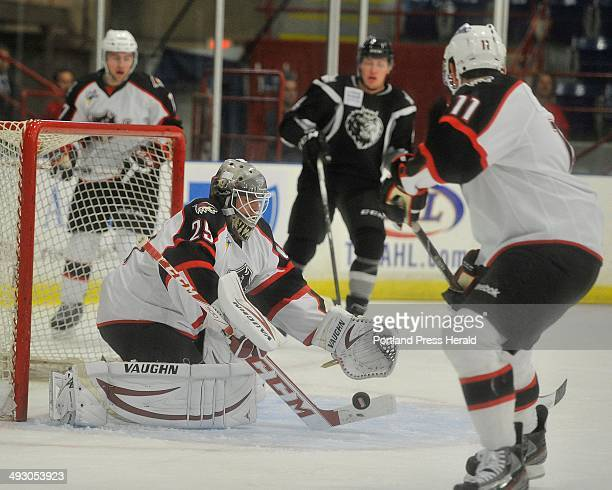 October 9 2013ë¦ Portland Pirates vs Manchester Monarchs at the Colisee in Lewiston Pirates goalie Mark Visentin blocks a shot in front of his goal...