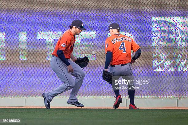 Houston Astros outfielders scramble for a loose ball during the MLB Playoff ALDS game 2 between the Houston Astros and the Kansas City Royals at...