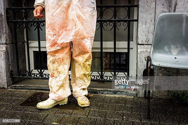 October Brussels Belgium During Eid alAdha many Muslim families sacrifice a sheep and share the meat with the poor A butcher takes a rest outside in...