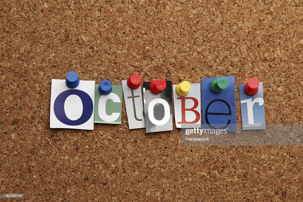 October pinned on noticeboard : Stock Photo