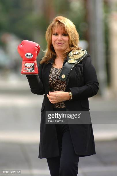 Jackie Kallen Brandishing a boxing glove and holding a replica World Boxing Champion belt. She is a Female boxing manager and promoter. Her greatest...