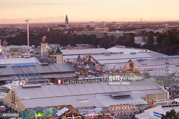 CONTENT] Octoberfest panorama Beer tents with Bavaria Sendling and Alpes in the background Munich Bavaria Germany