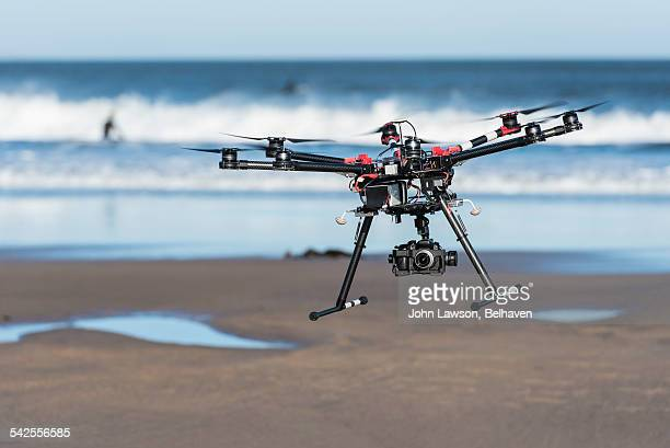 Octocopter drone hovering over a beach