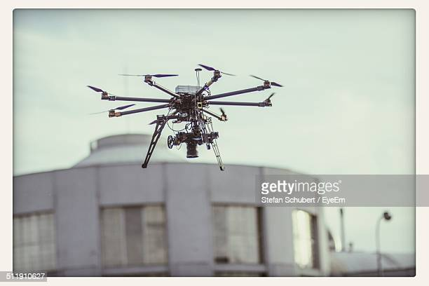 Octocopter flying against building