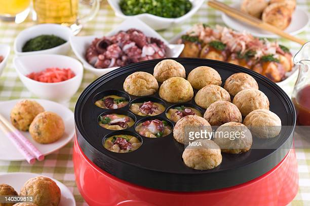 octopus ball on hot plate - takoyaki stock pictures, royalty-free photos & images